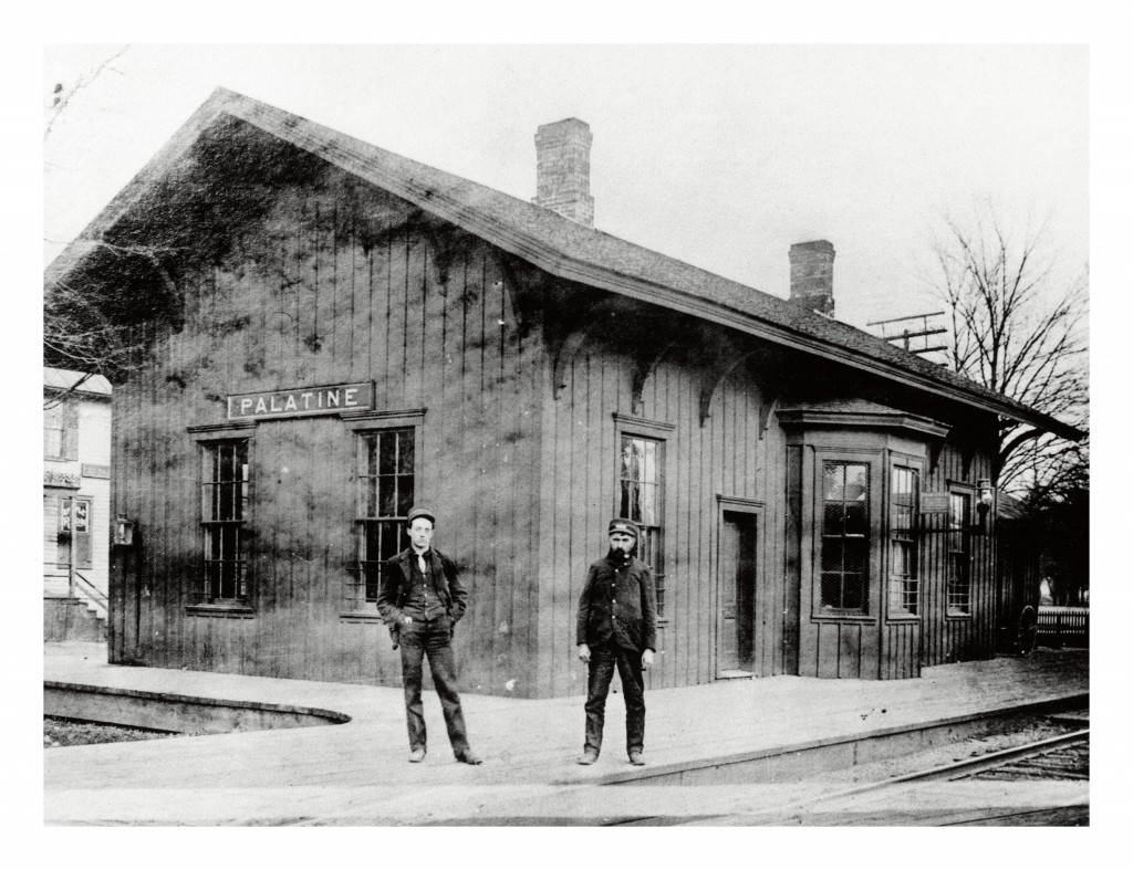 The depot was built circa 1855 by Hiram Thurston on land donated by Joel Wood. It was on the north side of the tracks.