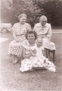 Matilda Foreman is the matriarch of this family of four generations of women. Her daughter, Ella Bedurske, is sitting to her left. Vietta Mickus, Ella's daughter, is sitting on the grass holding her daughter, Petronelle Smith. A copy of this photo was given to us by Vietta along with many other family photos. Matilda died in 1947, not too long after this photo was taken.